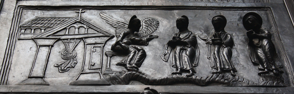 Detail from Bronze doors with scenes from the Old and New Testament in relief. Made at the order of St. Bernward, and set up by him in 1015 at St. Michael's Church, Hildesheim. They were since taken to the cathedral by his successor. This panel shows the Maries at the Sepulchre.