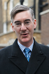 © Licensed to London News Pictures. 14/12/2018. London, UK.  Conservative MP, Jacob Rees-Mogg leaving his central London home this morning.  Photo credit: Vickie Flores/LNP