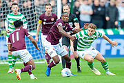 Arnaud Djoum (#10) of Heart of Midlothian and James Forrest(#49) of Celtic FC tussle for the ball during the Betfred League Cup semi-final match between Heart of Midlothian FC and Celtic FC at the BT Murrayfield Stadium, Edinburgh, Scotland on 28 October 2018.