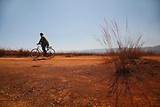 Man on bike cycling in the Highlands near Antsirabe Madagascar. September 2015.<br /> (Operation Smile Photographer &ndash; Zute Lightfoot)