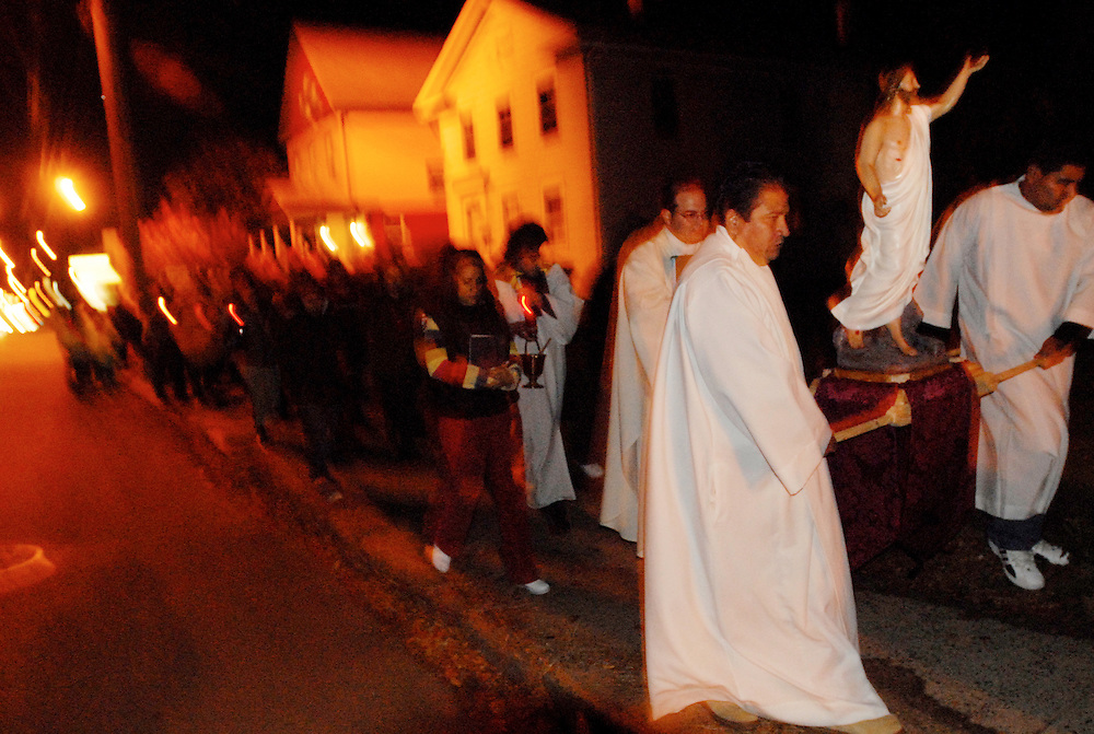 During a celebration of the Day of the Dead or Dia de los Muertos, Mexican parishioners from Most Holy Trinity Catholic Church lead a small procession to the cemetery on Route 5 in Wallingford, Connecticut on Nov. 2, 2006. El Dia de los Muertos is widely observed in Mexico each year. Participants gather in cemeteries to pay homage and respect to deceased family and friends.