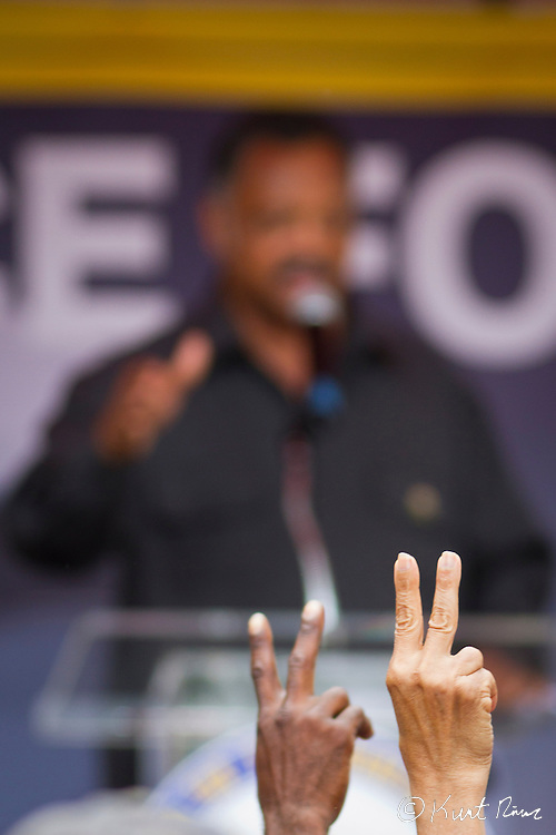 March 31, 2012 - Sanford, Florida, U.S. - People in the crowd wave peace signs as JESSE JACKSON speaks at the rally in Sanford, Florida for the justice of Treyvon Martin.