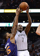 Nov 15, 2013; Phoenix, AZ, USA; Brooklyn Nets guard Joe Johnson (7) handles the ball against the Phoenix Suns forward Marcus Morris (15) in the first half at US Airways Center. The Nets defeated the Suns 100-98 in overtime. Mandatory Credit: Jennifer Stewart-USA TODAY Sports