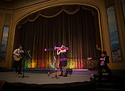 Master of Ceremonies Kevin Cook (R) tries to give Susan Dickson the hook while playing a trombone during a Vaudeville Show at the 100-year-old Patricia Theatre in Powell River, BC (2013)
