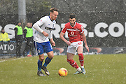 Bury Defender, Chris Hussey and Walsall Midfielder, Anthony Forde battle forr the ball during the Sky Bet League 1 match between Bury and Walsall at Gigg Lane, Bury, England on 16 January 2016. Photo by Mark Pollitt.