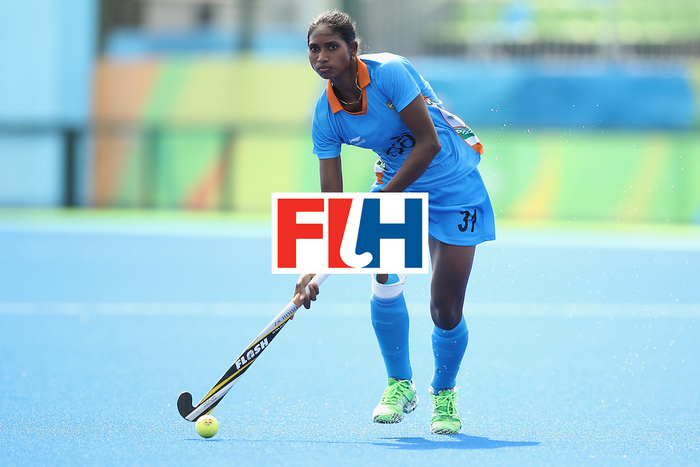 RIO DE JANEIRO, BRAZIL - AUGUST 07:  Lilima Minz of India runs the ball during the women's pool B match between Japan and India on Day 2 of the Rio 2016 Olympic Games at the Olympic Hockey Centre on August 7, 2016 in Rio de Janeiro, Brazil.  (Photo by Mark Kolbe/Getty Images)
