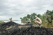 life-size sculptures by Rita Longa at the reconstructed Taino village of Guamá, Cuba depicting the life of this indigenous tribe