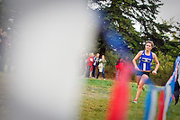 Coeur d'Alene High's Kinsey Gomez closes in on the finish line to end her 5k race with a time of 19:29 Saturday at the Super One Invitational cross country races at Farragut State Park.