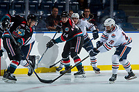 KELOWNA, CANADA - SEPTEMBER 5: Jack Cowell #8 of the Kelowna Rockets is stick checked by Connor Zary #18 of the Kamloops Blazers on September 5, 2017 at Prospera Place in Kelowna, British Columbia, Canada.  (Photo by Marissa Baecker/Shoot the Breeze)  *** Local Caption ***
