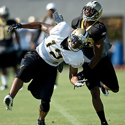 July 31, 2011; Metairie, LA, USA; New Orleans Saints cornerback Jabari Greer (33) deflects the ball away from wide receiver Marques Colston (12) before intercepting the ball during training camp practice at the New Orleans Saints practice facility. Mandatory Credit: Derick E. Hingle