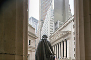 The rear of the George Washington statue as seen from the Federal Hall towards the NYSE Euronext Stock Exchange.