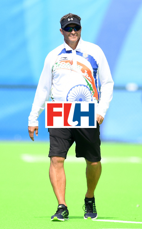 India's coach  Neil Andrew Hawgood walks on the sidelines during the women's field hockey Japan vs India match of the Rio 2016 Olympics Games at the Olympic Hockey Centre in Rio de Janeiro on August, 7 2016. / AFP / MANAN VATSYAYANA        (Photo credit should read MANAN VATSYAYANA/AFP/Getty Images)