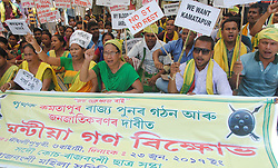 June 22, 2017 - Guwahati, India - Activists of All Assam Koch Rajbongshi Student's Union (AAKRSU) staging a demonstration in front of Dighalipukhuri in Guwahati, the capital city of North-East India on Friday, June 23, 2017, demanding ST status for the people of Koch Rajbongshi community and demanding separate Kamatapur state. (Credit Image: © Rajib Jyoti Sarma/Pacific Press via ZUMA Wire)