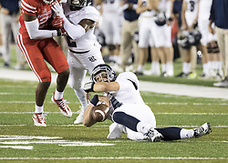September 16, 2017 - Houston, TX, USA - Rice Owls quarterback Sam Glaesmann (4) fumbles the ball after being tripped up in the backfield during the second quarter of the college football game between the Houston Cougars and the Rice Owls at TDECU Stadium in Houston, Texas. (Credit Image: © Scott W. Coleman via ZUMA Wire)