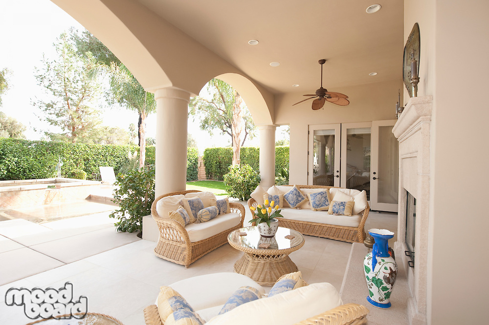 Neutral outdoor room with cane furniture