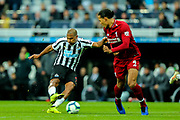 Jose Salomon Rondon (#9) of Newcastle United shoots from outside the penalty box during the Premier League match between Newcastle United and Liverpool at St. James's Park, Newcastle, England on 4 May 2019.