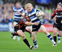 Bath winger Tom Biggs is tackled in possession - Photo mandatory by-line: Patrick Khachfe/JMP - Tel: Mobile: 07966 386802 19/10/2013 - SPORT - RUGBY UNION - Recreation Ground - Bath - Bath V Newport Gwent Dragons - Amlin Challenge Cup