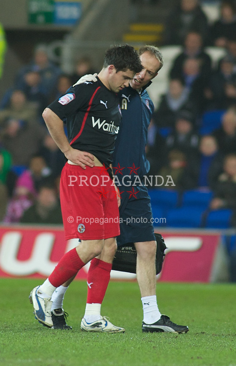 CARDIFF, WALES - Tuesday, February 1, 2011: Reading's Shane Long is forces off injured early in the match during the Football League Championship match at the Cardiff City Stadium. (Photo by Gareth Davies/Propaganda)