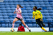 Lizzie Arnot (#23) of Scotland cuts inside with the ball, pursued by Sashana Campbell (#12) of Jamaica during the International Friendly match between Scotland Women and Jamaica Women at Hampden Park, Glasgow, United Kingdom on 28 May 2019.