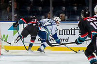 KELOWNA, CANADA - OCTOBER 23:  Lane Zablocki #27 of the Kelowna Rockets tries to check Garrett Sambrook #27 of the Swift Current Broncos as he skates with the puck during second period on October 23, 2018 at Prospera Place in Kelowna, British Columbia, Canada.  (Photo by Marissa Baecker/Shoot the Breeze)