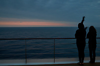 Students watching the sun setting over the Atlantic Ocean.  Image taken with a Leica X2 camera.