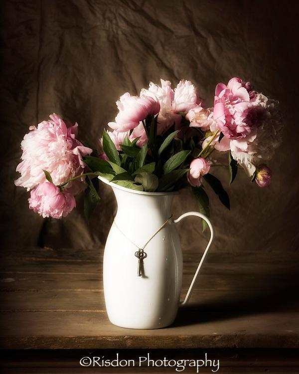 Still life pink peonies in white metal vase