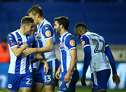 Will Grigg of Wigan Athletic celebrates with teammates after scoring a goal to make it 1-0 - Mandatory by-line: Robbie Stephenson/JMP - 19/02/2018 - FOOTBALL - DW Stadium - Wigan, England - Wigan Athletic v Manchester City - Emirates FA Cup fifth round proper