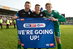 Free to use courtesy of Sky Bet - Christian Walton Jamie Jones and Dan Lavercombe of Wigan Athletic celebrate winning promotion to the Sky Bet Championship- Mandatory by-line: Robbie Stephenson/JMP - 21/04/2018 - FOOTBALL - Highbury Stadium - Fleetwood, England - Fleetwood Town v Wigan Athletic - Sky Bet League One