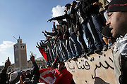 Tunisians from province protest under the the Prime Minister's office demanding the dissolution of the interim governement.