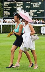 Two racegoers in the parade ring on the second day of Glorious Goodwood<br /> London,  Wednesday, 31st July 2013<br /> Picture by Stephen Lock / i-Images