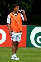 Photo: Richard Lane.<br />England Training Session. 22/05/2006.<br />Theo Walcott takes a drink during training.