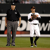 25 September 2007:  Umpire Gary Cedestrom (L) talks with Baltimore Orioles second baseman Brian Roberts (R) during the game between the Toronto Blue Jays and the Baltimore Orioles.  The Blue Jays defeated the Orioles 11-4 at Camden Yards in Baltimore, MD.  ****For Editorial Use Only****