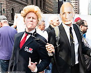 A fake Donald Trump on a leash held by a fake Vladimir Putin at a protest rally against Donald Trump outside the Lotte New York Palace Hotel in New York City where he is expected on May 23, 2018