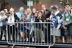 "© Licensed to London News Pictures. 27/07/2019. Manchester, UK. A crowd of onlookers , including some gesturing with their fingers in an ""O"" shape - historically meaning OK and recently adopted by some to indicate white supremacy - gather to catch a glimpse of British Prime Minister Boris Johnson leaving the Science and Industry Museum after a speech in Manchester City Centre . Johnson was due to re-announce the HS3 rail link between Manchester and Leeds . Photo credit: Joel Goodman/LNP"