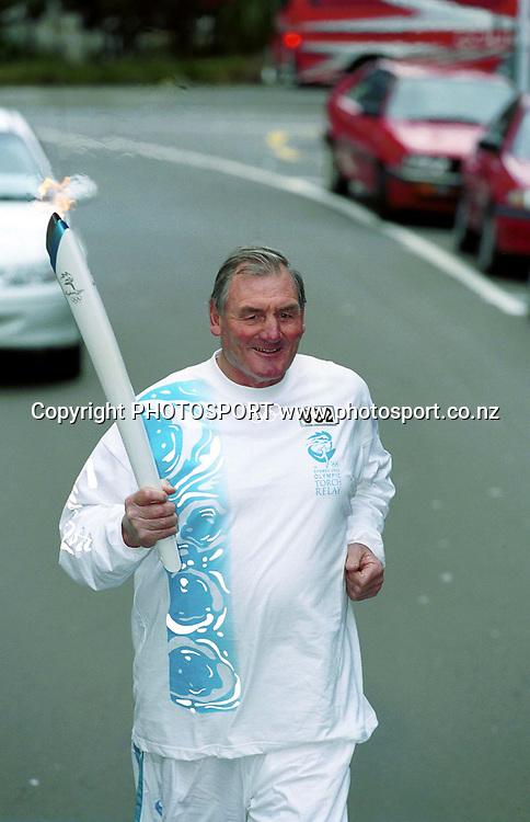 Brian lochore carries the Olympic Torch for a stretch on the New Zealand leg, 2000. Photo: Dean Treml/PHOTOSPORT