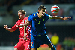 SWANSEA, ENGLAND - Friday, September 4, 2009: Wales' Simon Church and Italy's Andrea Ranocchia during the UEFA Under 21 Championship Qualifying Group 3 match at the Liberty Stadium. (Photo by David Rawcliffe/Propaganda)