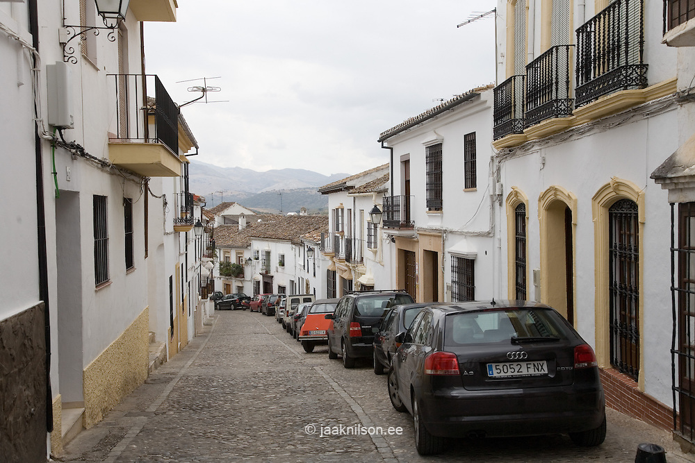 Narrow Street and Cars in Ronda, Andalucia, Spain