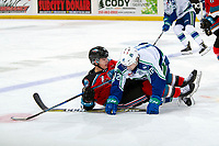 KELOWNA, BC - OCTOBER 16:  Leif Mattson #28 of the Kelowna Rockets and Eric Houk #12 of the Swift Current Broncos fall to the ice after checking during second period at Prospera Place on October 16, 2019 in Kelowna, Canada. (Photo by Marissa Baecker/Shoot the Breeze)