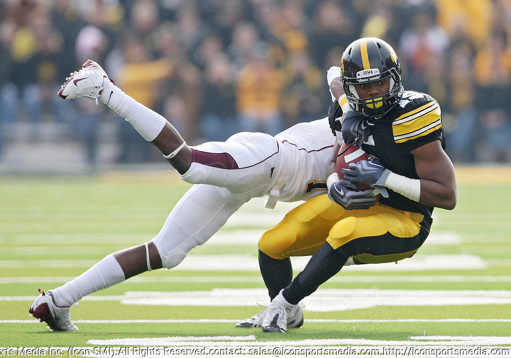 November 21, 2009: Iowa wide receiver Derrell Johnson-Koulianos (15) is hit by Minnesota cornerback Michael Carter (1) during the first half of the Iowa Hawkeyes 12-0 win over the Minnesota Golden Gophers at Kinnick Stadium in Iowa City, Iowa on November 21, 2009.