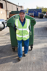 Man with a mild learning disability working as a factory cleaner, shown here with bins, helped into employment by the Ready 4 Work team, Nottinghamshire County Council