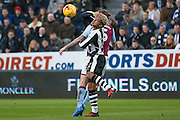 Aston Villa midfielder Henri Lansbury (5)  catches Newcastle United defender DeAndre Yedlin (22) in the face during the EFL Sky Bet Championship match between Newcastle United and Aston Villa at St. James's Park, Newcastle, England on 20 February 2017. Photo by Simon Davies.