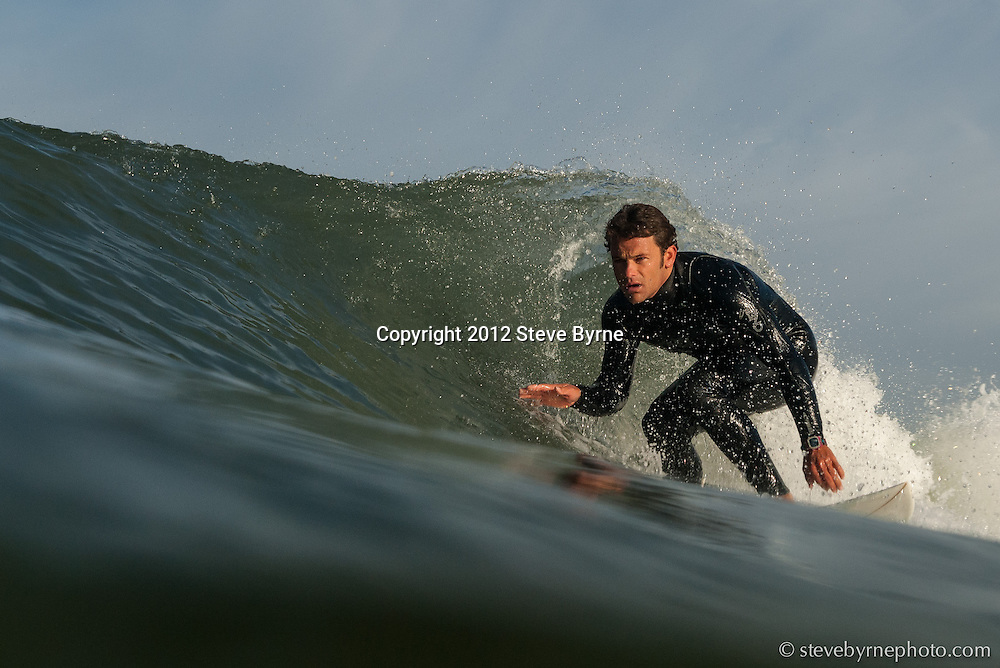 A surfer finesses the pocket of a wave at Ocean Beach.  San Francisco, California.