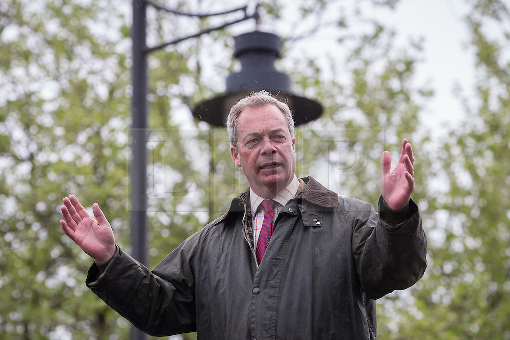 © Licensed to London News Pictures . 25/05/2016 . Bolton , UK . NIGEL FARAGE speaks from the top of the bus . The UKIP referendum bus tour , campaigning for a UK Brexit , lead by Nigel Farage , in Victoria Square , Bolton . Photo credit : Joel Goodman/LNP