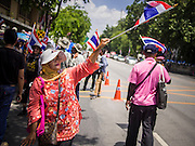 03 SEPTEMBER 2013 - BANGKOK, THAILAND:  A woman waves a Thai flag while protesting the price of cooking gas at Government House in Bangkok. The Thai government raised the price of Liquified Propane Gas (LPG - cooking gas) by 50 satang per kilogram (about 1.5 cents US) over the weekend. The price of electricity and highway tolls also went up on the same day dealing most Thais a triple blow. The Thai consumers foundation has filed a suit in Thai administrative courts to block the increase but the courts have not yet ruled on the case. About 50 people protested the price hike at Government House in Bangkok and delivered a letter outlining their objections to a representative of the Prime Minister.   PHOTO BY JACK KURTZ