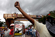 Protestors march in support of President Zelaya in Tegucigalpa on July 3, 2009. Zelaya is supposed to return this weekend, however the current government has promised to put him in jail if he enters the country.