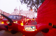 Blurred for effect, a scooter rider's view while negotiating Rome's rush hour traffic.