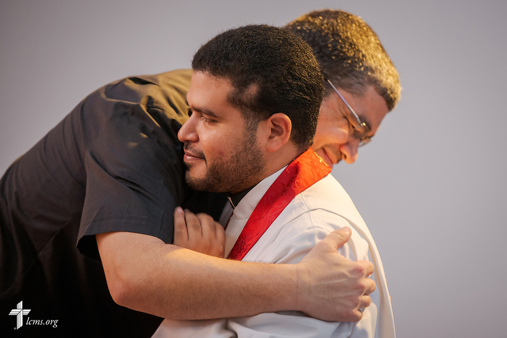 The Rev. Angel Ramos, pastor of Faith Lutheran Church, Clewiston, Fla., hugs the Rev. Gustavo Maita, pastor of Iglesia Luterana Principe de Paz (Prince of Peace Lutheran Church), Mayagüez, Puerto Rico, after Maita was installed as pastor of the church during worship on Sunday, April 15, 2018. LCMS Communications/Erik M. Lunsford