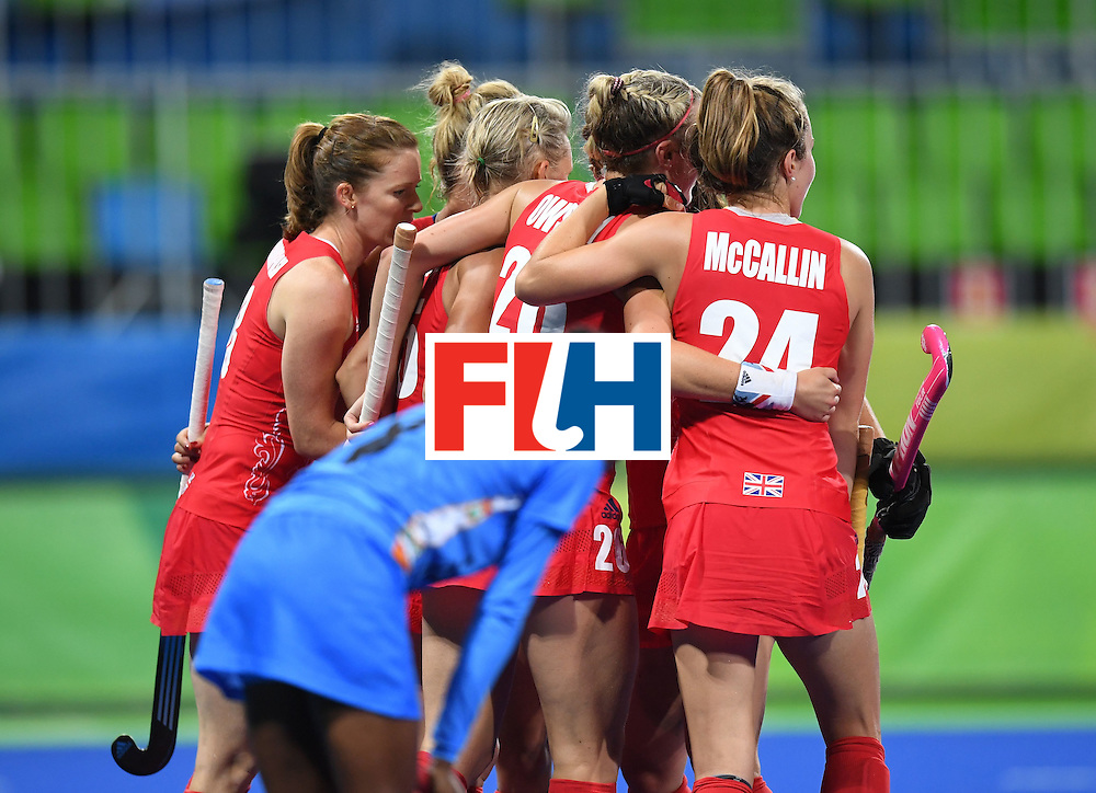 Britian players celebrate a goal during the women's field hockey India vs Britain match of the Rio 2016 Olympics Games at the Olympic Hockey Centre in Rio de Janeiro on August, 8 2016. / AFP / MANAN VATSYAYANA        (Photo credit should read MANAN VATSYAYANA/AFP/Getty Images)