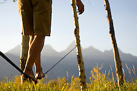 A young man walks a slackline in Grand Teton National Park, Jackson Hole, Wyoming.