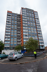 © Licensed to London News Pictures. 25/09/2019. Headington, UK. A view of Foresters Tower with a broken window visible at a top floor apartment and a forensic tent on the ground floor. Thames Valley Police were called to Foresters Tower in Wood Farm Road, Headington, at 21:18 BST on 24th September 2019 to reports that a man had fallen from an upper floor of Foresters Tower. The man died at the scene. <br /> Following a search of flats at Foresters Tower, a woman was located on the fourth floor with severe neck injuries and was pronounced dead at the scene.. Photo credit: Peter Manning/LNP